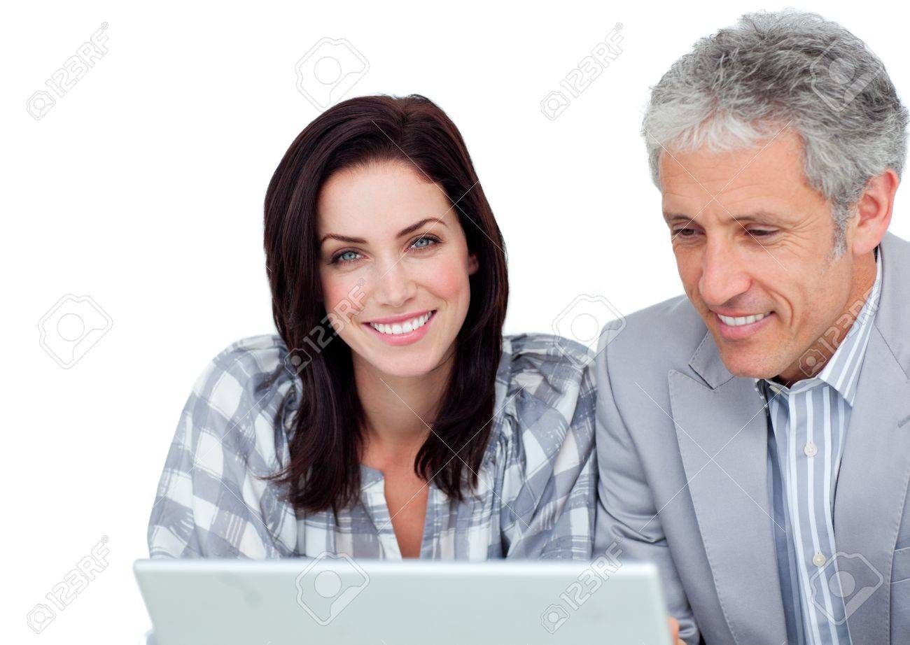 Two positive business co-workers using a laptop Stock Photo - 10258270