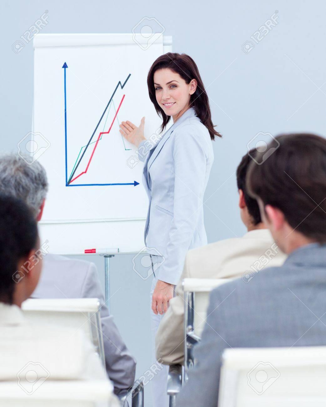 Beautiful businesswoman reporting sales figures Stock Photo - 10256182