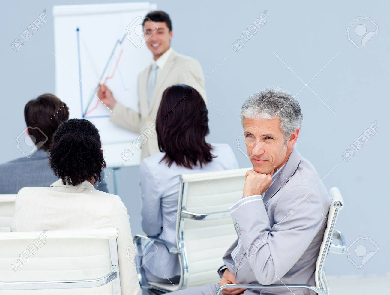 Charming businessman looking at the camera at a conference Stock Photo - 10259146