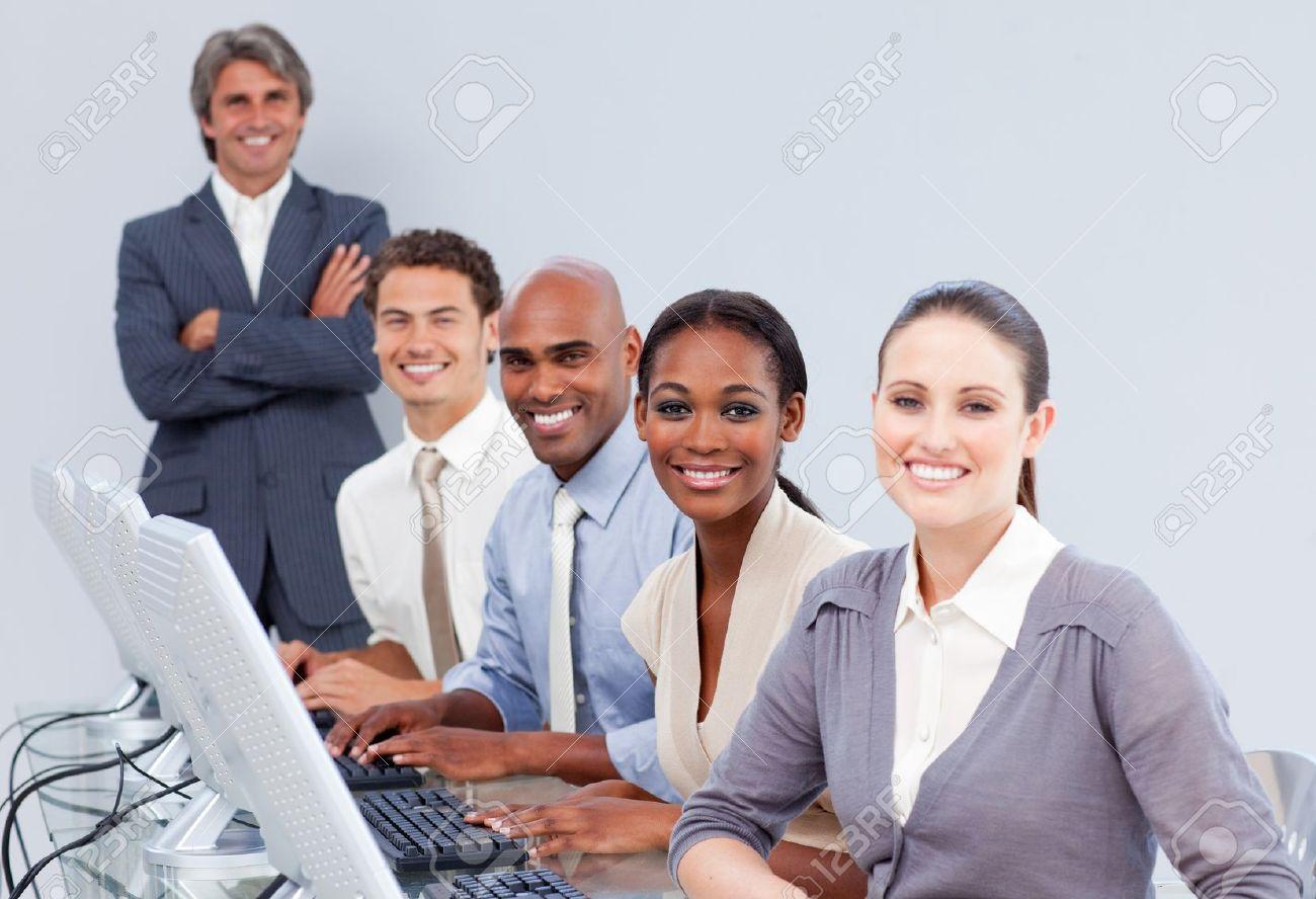 Happy customer service representatives in a call-center Stock Photo - 10258660