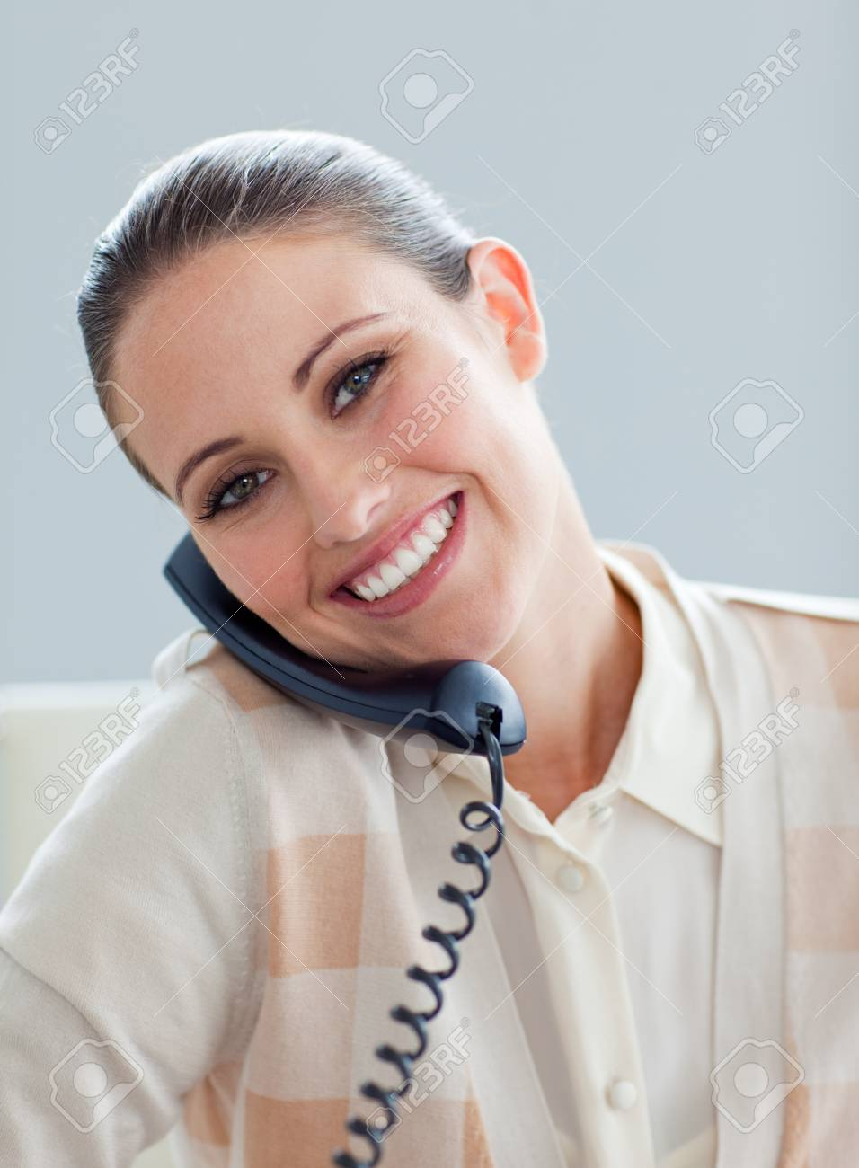 Positive businesswoman talking on phone Stock Photo - 10258738