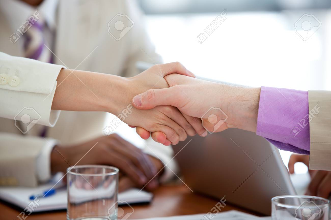 Close-up of two business people shaking hands Stock Photo - 10257984