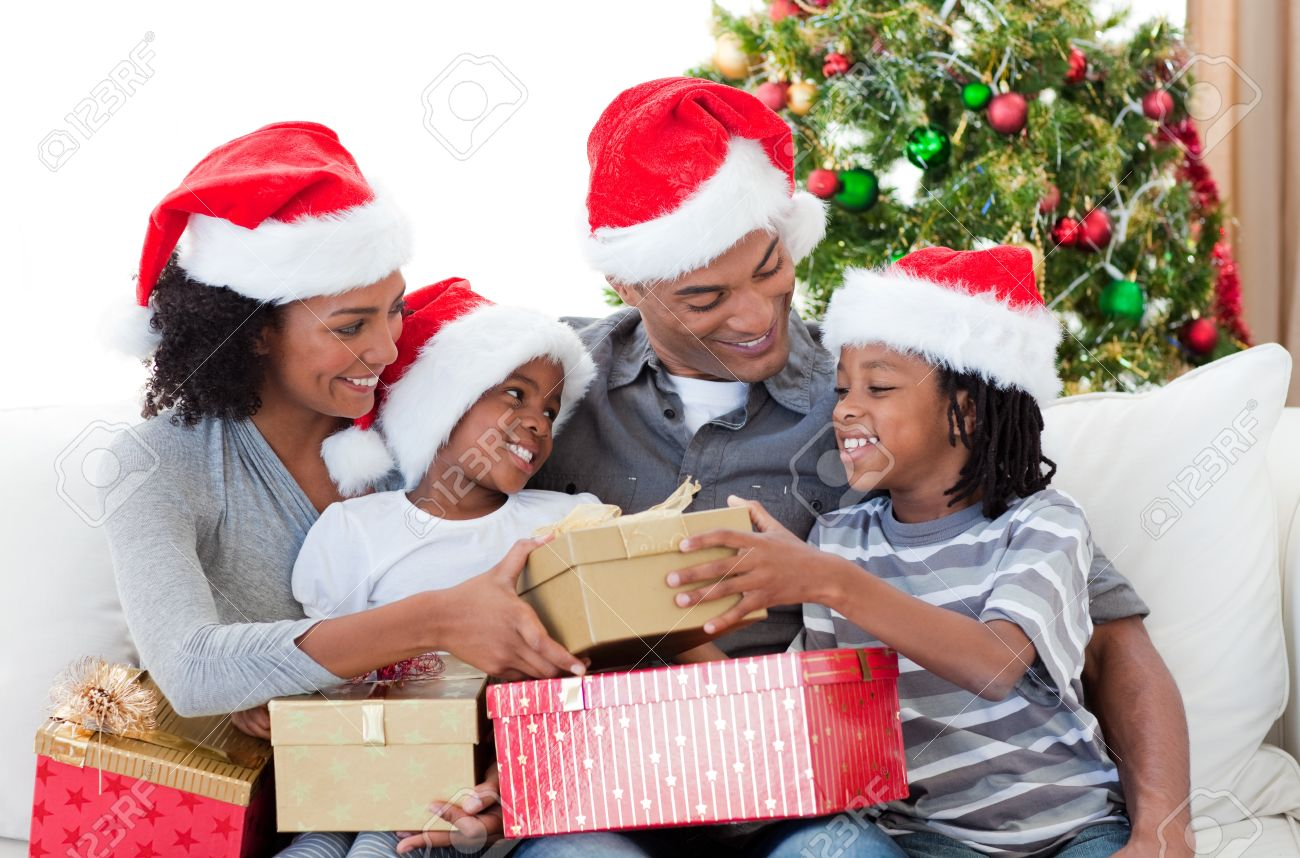 Family Christmas Gifts.Afro American Family Holding Christmas Gifts