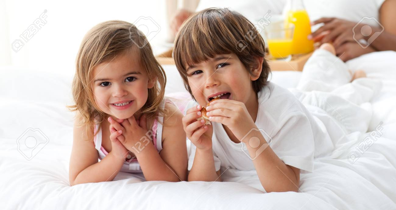 Cute brother and sister having breakfast Stock Photo - 10232470