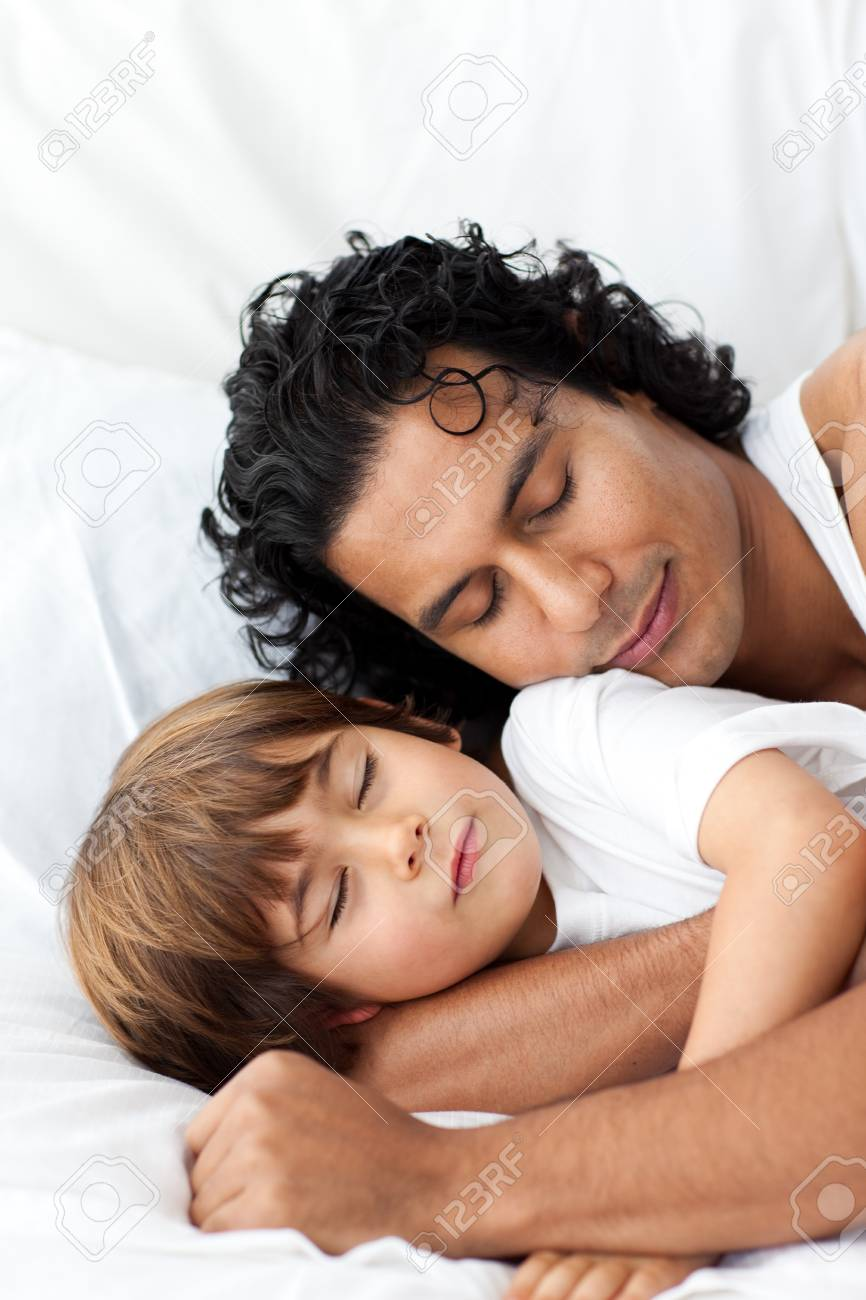 Little boy and his father sleeping together Stock Photo - 10242233