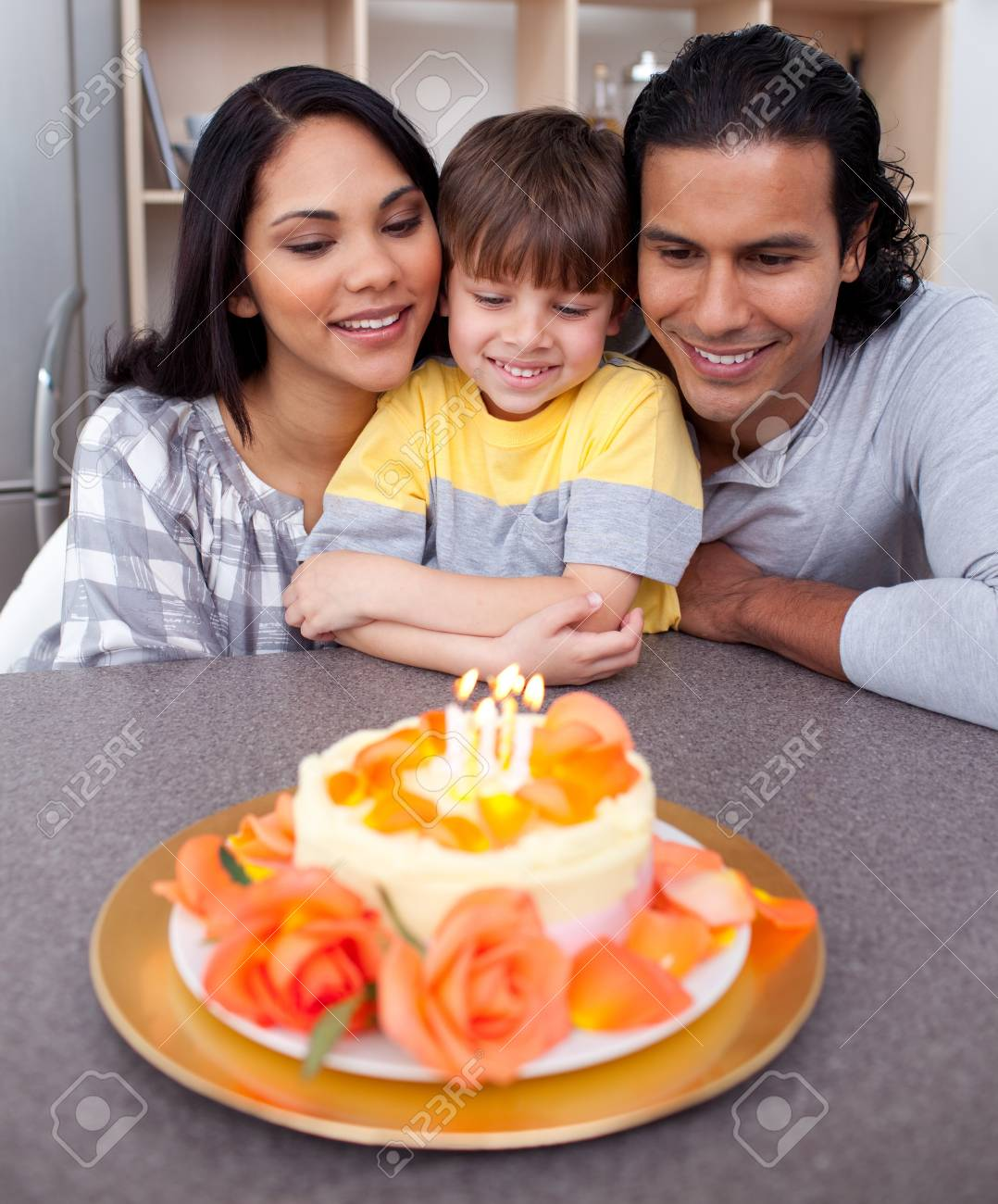 Little boy celebrating his birthday with his parents Stock Photo - 10240059