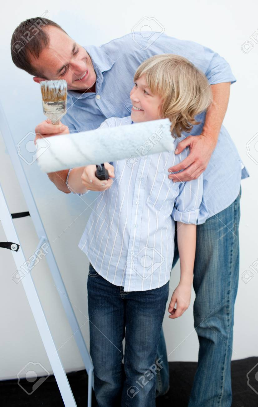 Happy father and his son painting a wall Stock Photo - 10259343