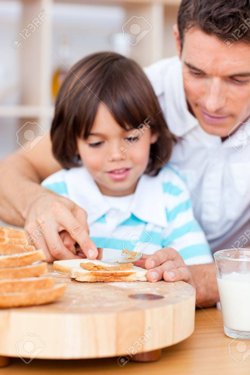 Affectionate father and his son spreading jam on bread Stock Photo - 10258353