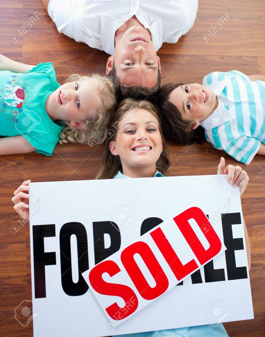 Happy family celebrating buying their new house Stock Photo - 10257057