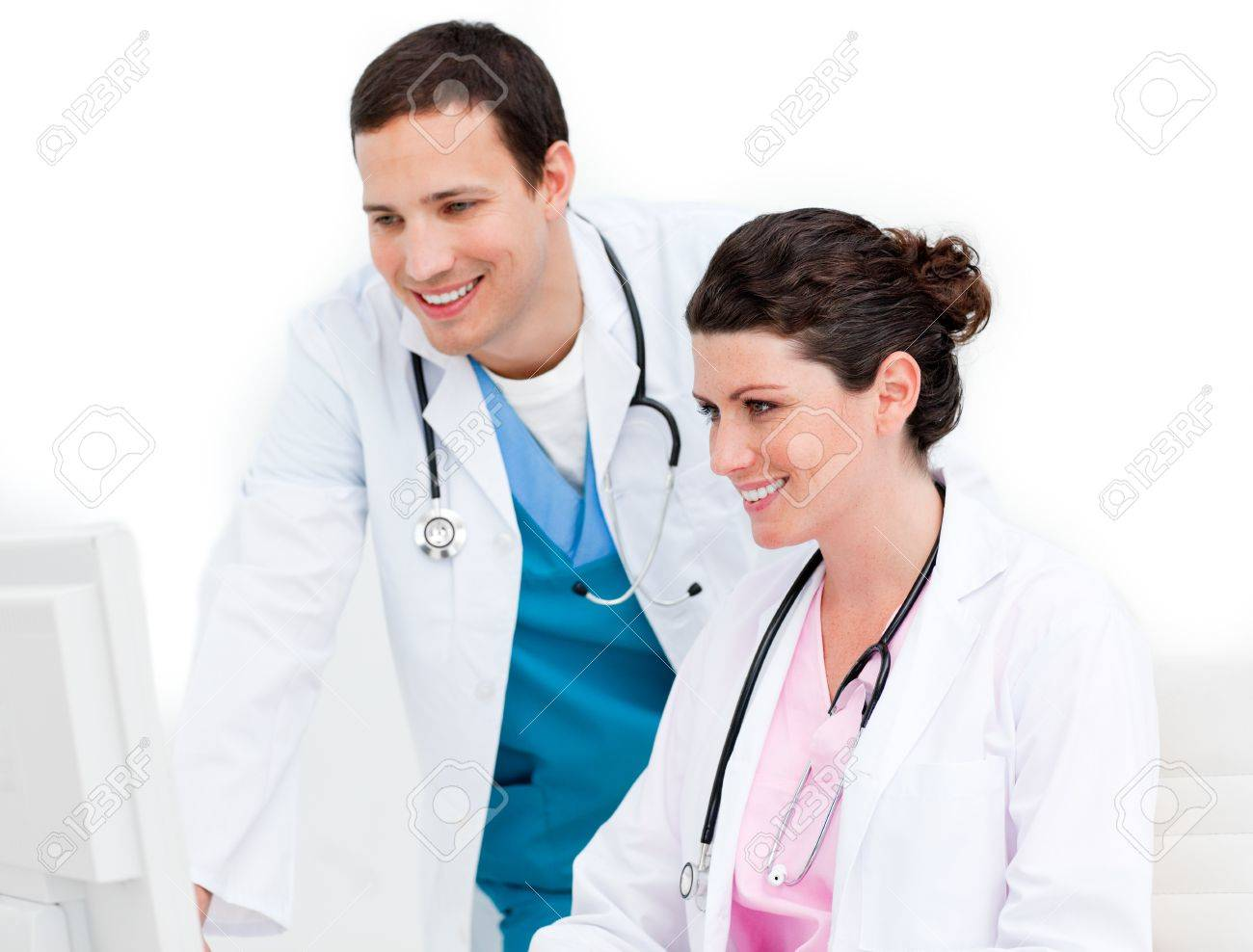 Smiling medical team working at a computer Stock Photo - 10243915
