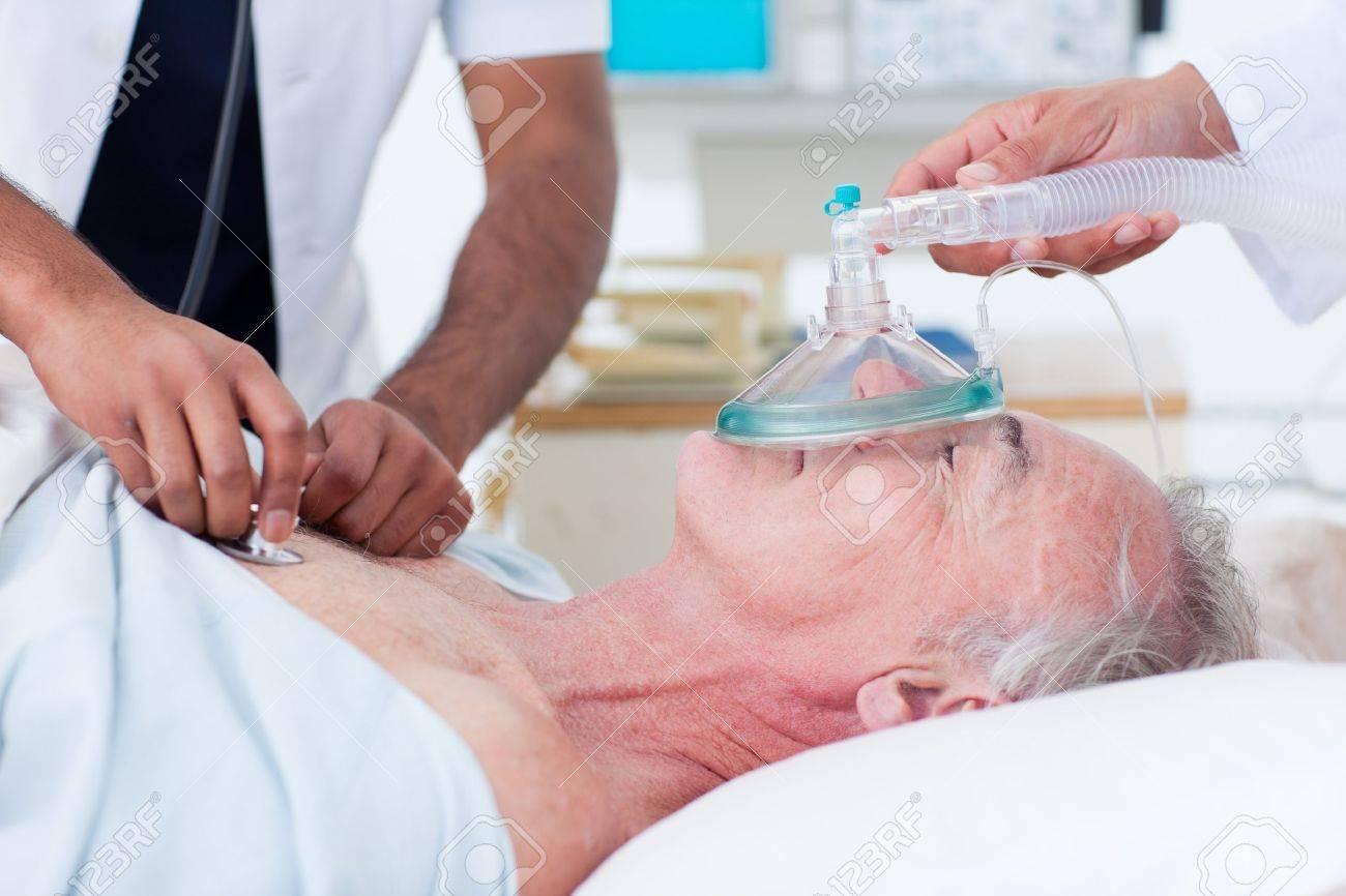 Doctors resuscitating a senior patient Stock Photo - 10259287