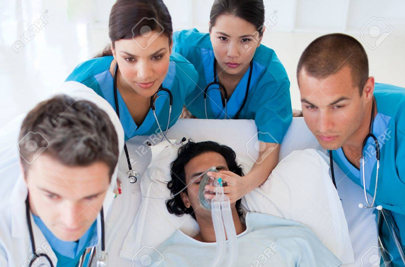 Emergency team carrying a patient Stock Photo - 10232174