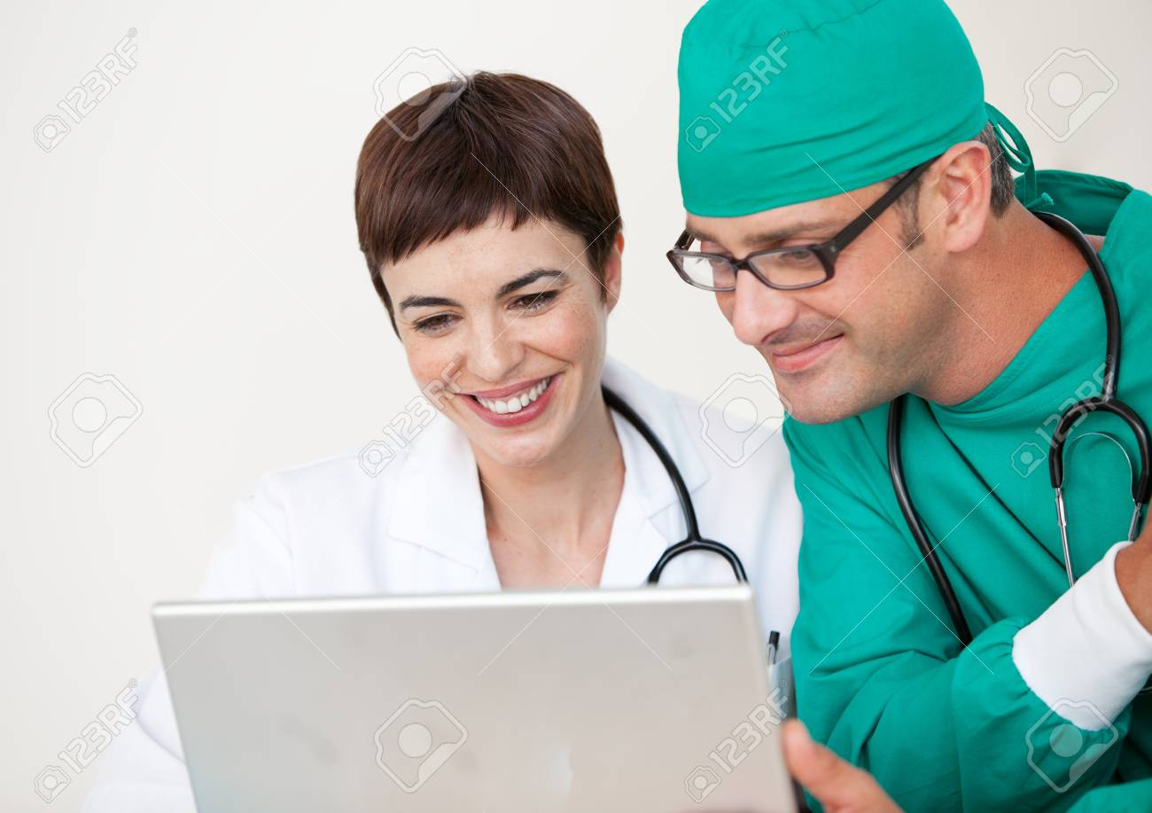 Doctor and surgeon looking at a laptop Stock Photo - 10258850