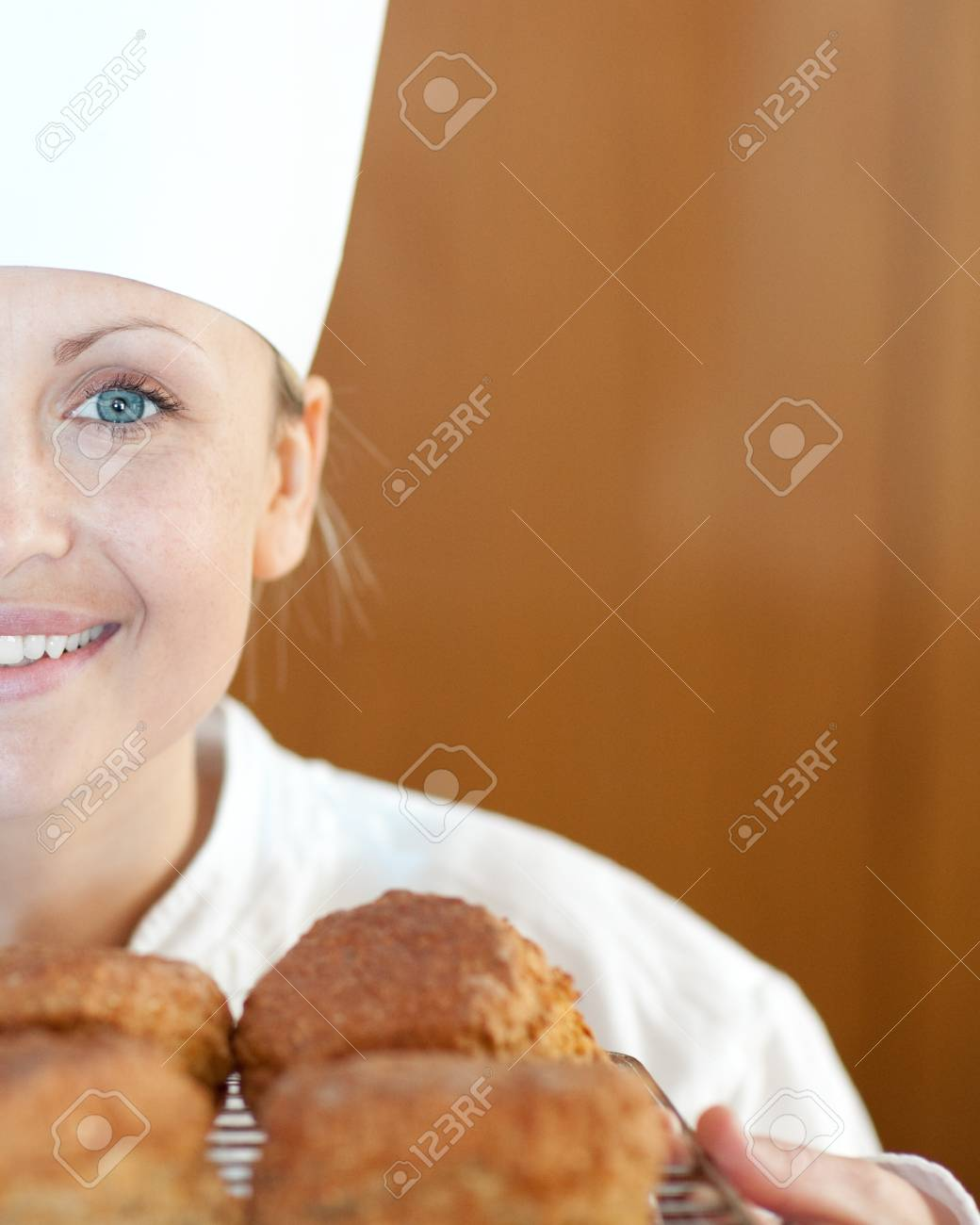 Close-up of a smiling female chef baking scones Stock Photo - 10232414