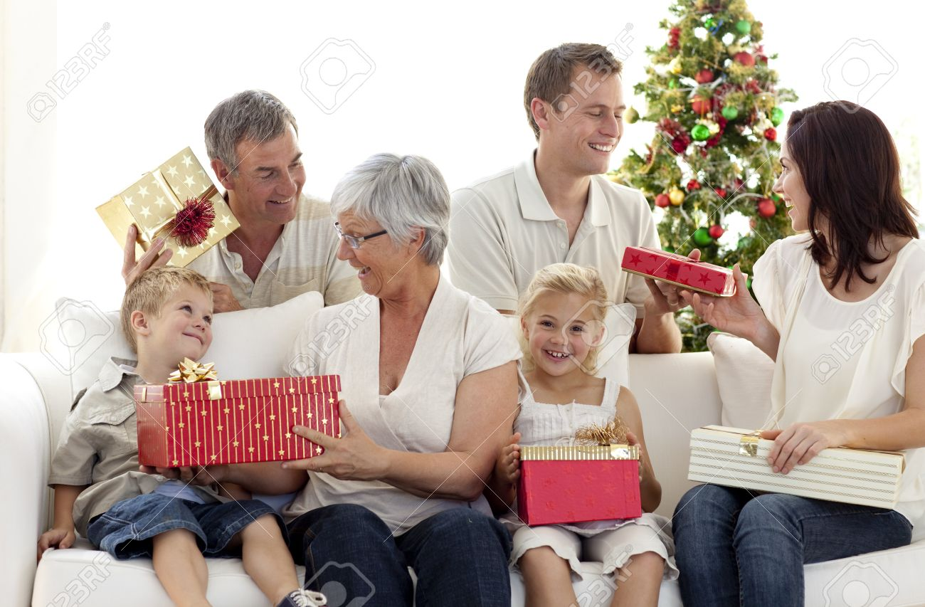 Family Opening Christmas Gifts At Home Stock Photo, Picture And ...