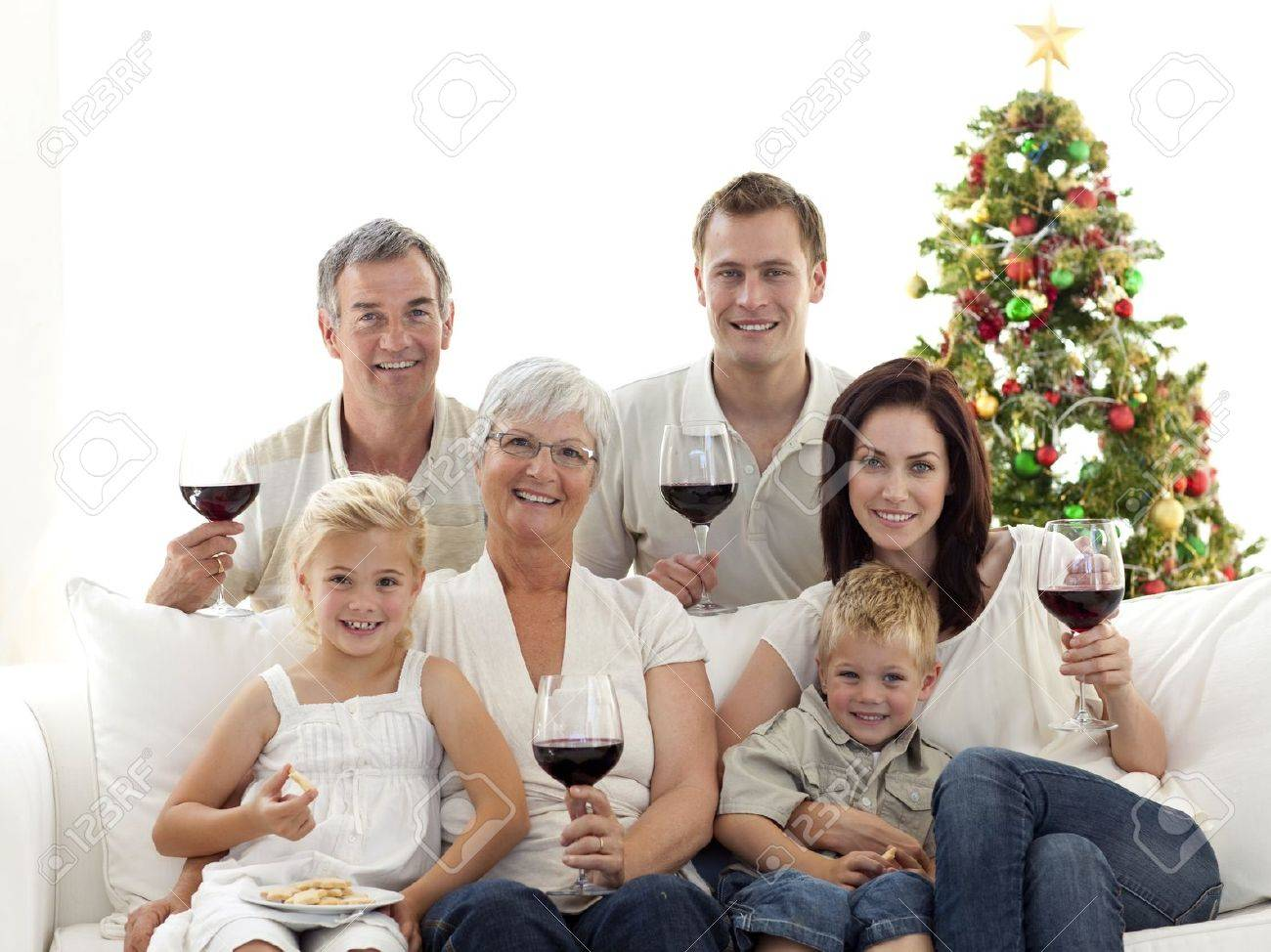 Family drinking wine and eating sweets in Christmas Stock Photo - 10258775