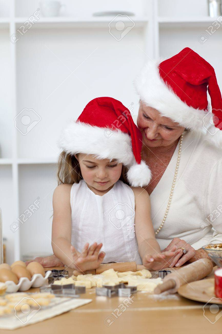 Grandmother and little girl baking Christmas cakes Stock Photo - 10257342