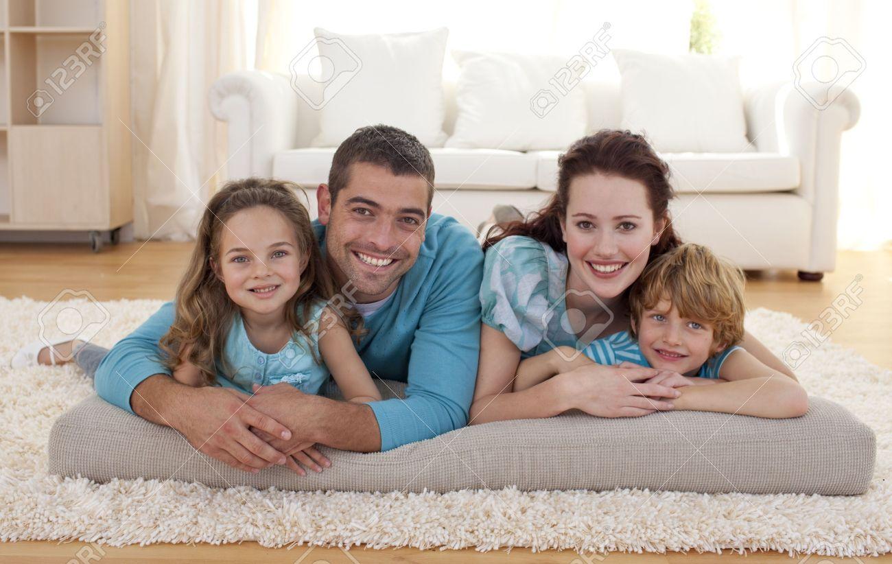 Family on floor in living-room Stock Photo - 10255975