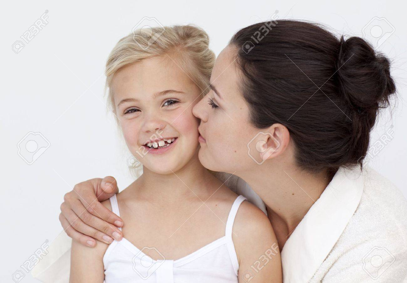 Mother Kissing Her Daughter In Bathroom Stock Photo Picture And