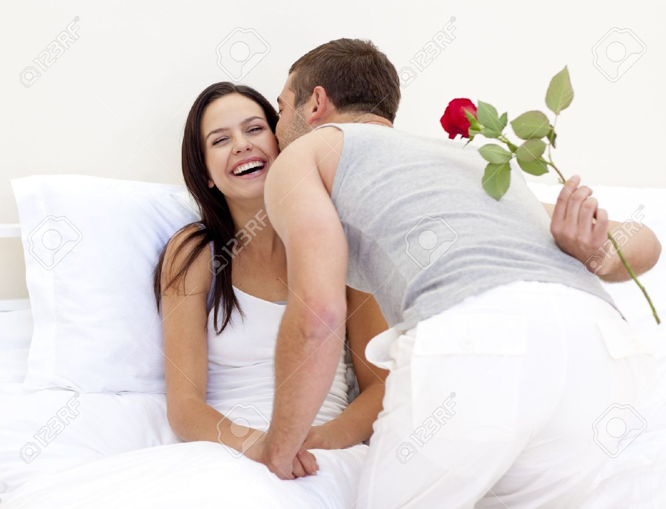 Man giving a rose and a kiss to his beautiful wife Stock Photo - 10232130