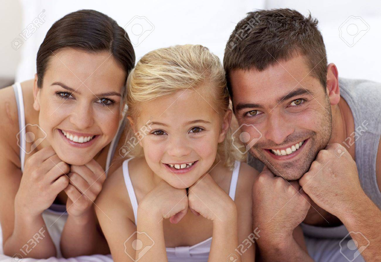 Lovely parents with their little daughter Stock Photo - 10238446
