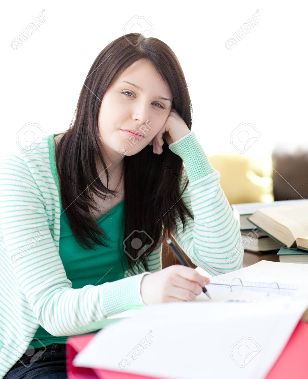 Tired attractive student sleeping while doing her homework Stock Photo - 10259515