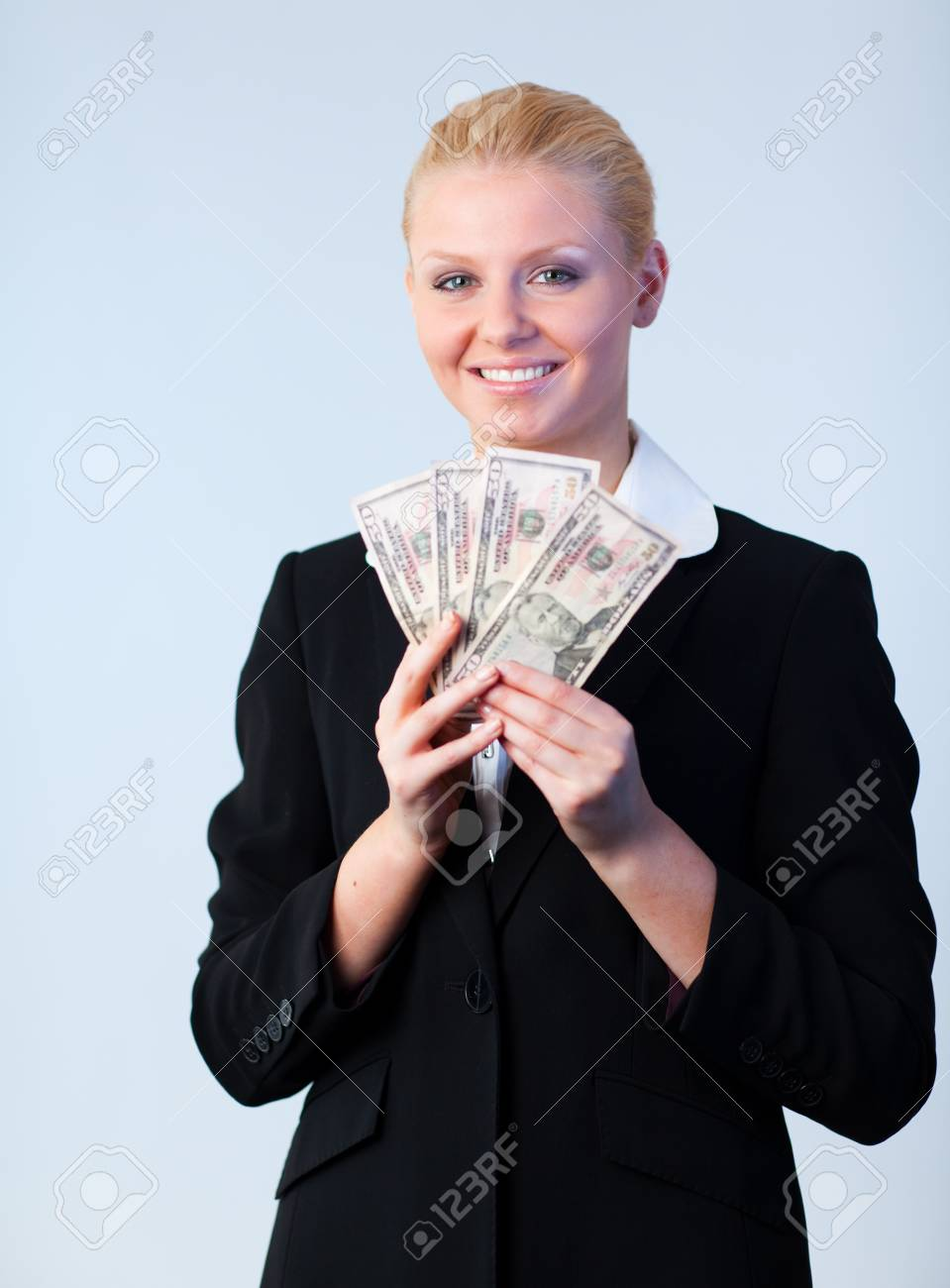 Business woman holding dollars to the camera Stock Photo - 10259476