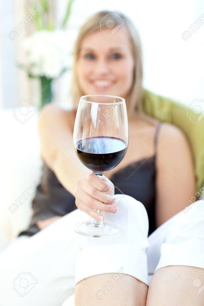 Radiant woman drinking red wine Stock Photo - 10250310