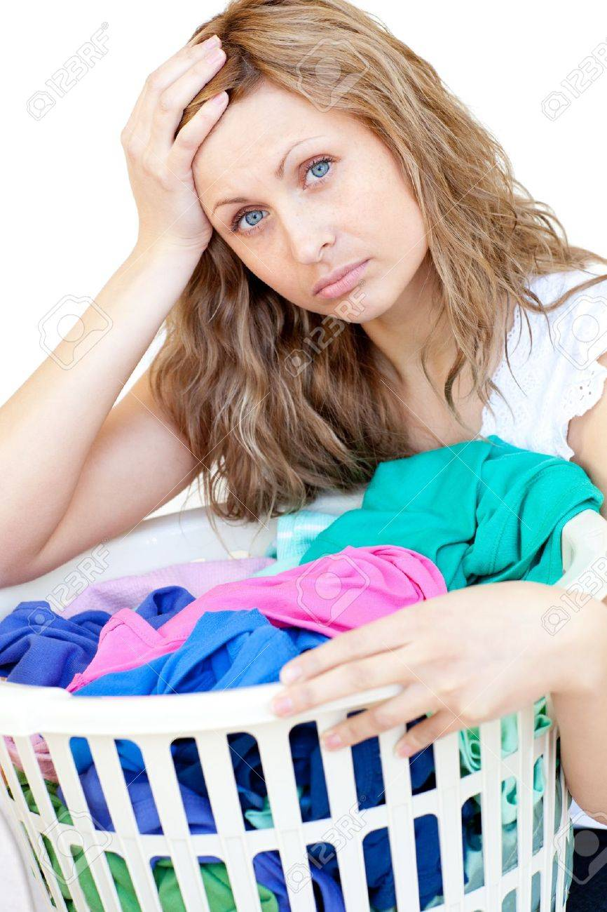 Tired woman doing laundry Stock Photo - 10250256