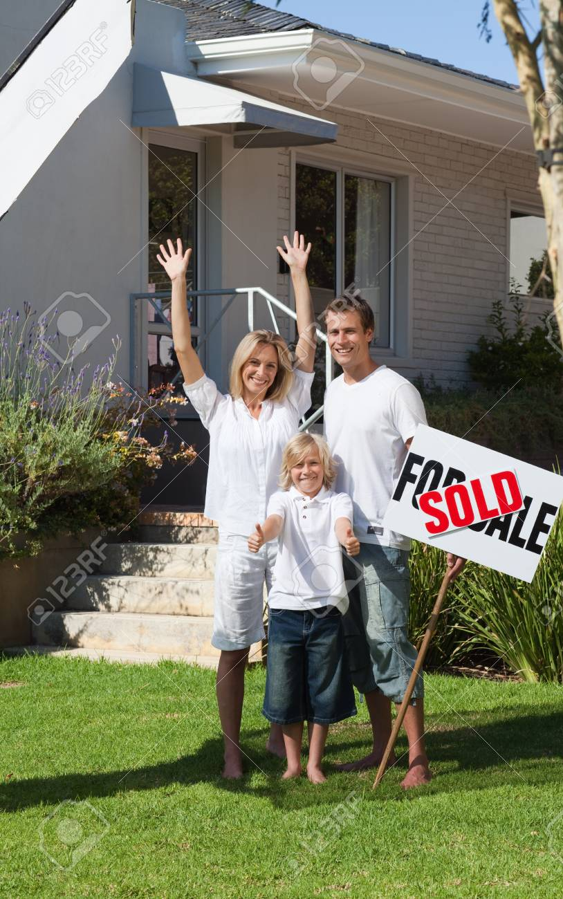 Happy family with their new home in the garden Stock Photo - 10249054