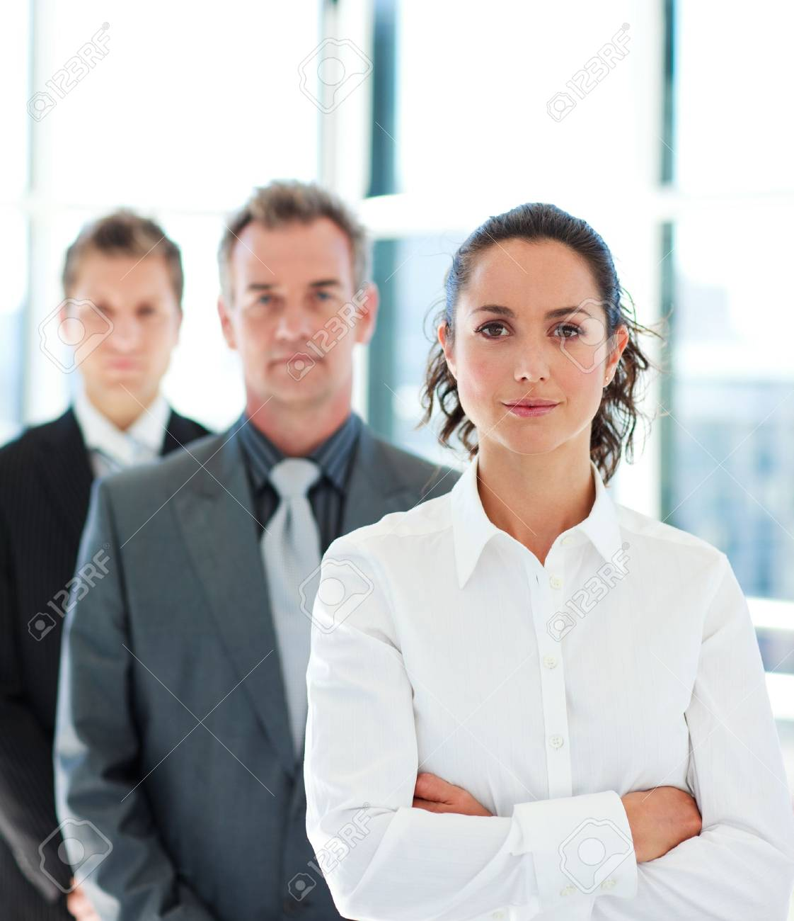 Businesswoman with folded arms in a line Stock Photo - 10246103