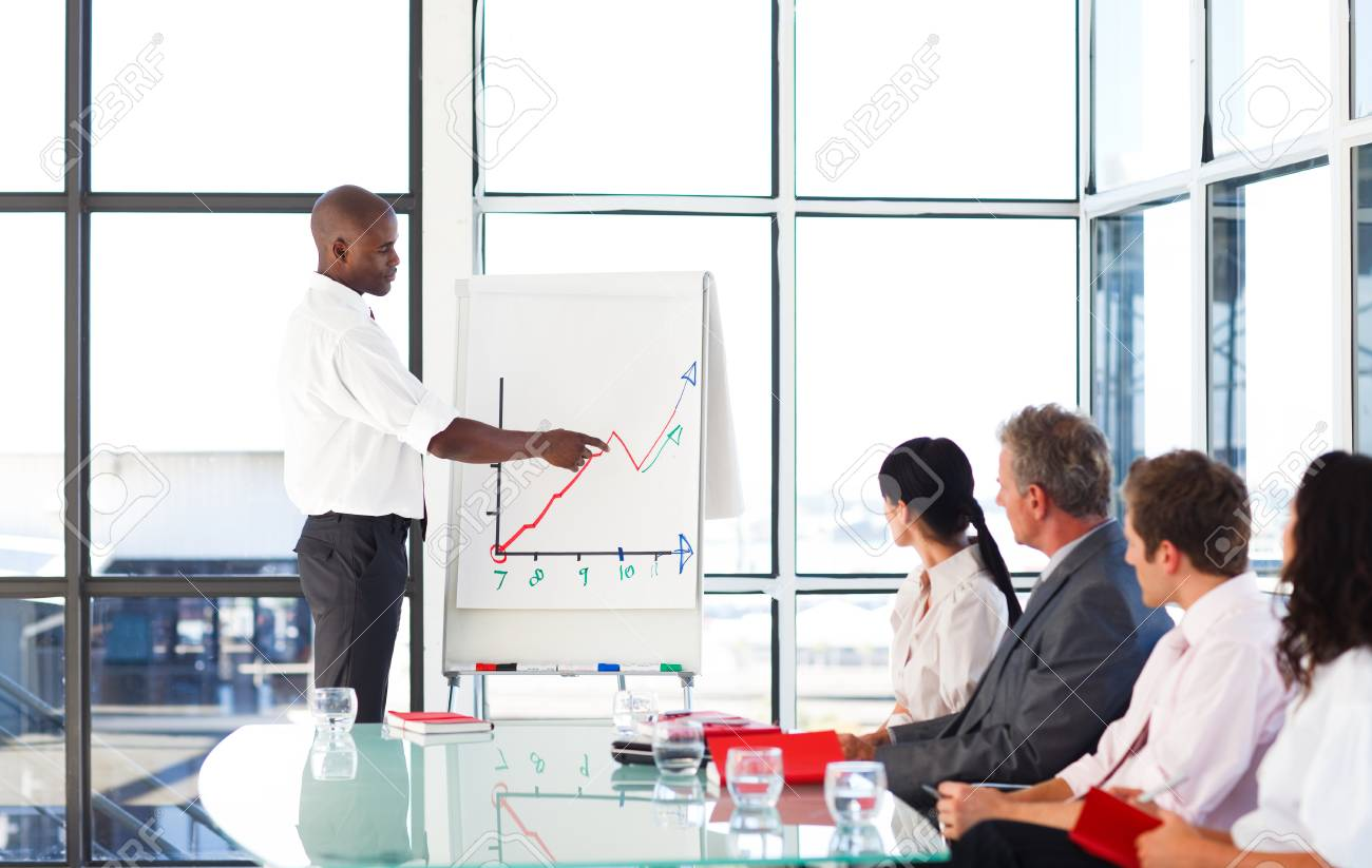 Young businessman giving a presentation Stock Photo - 10247425
