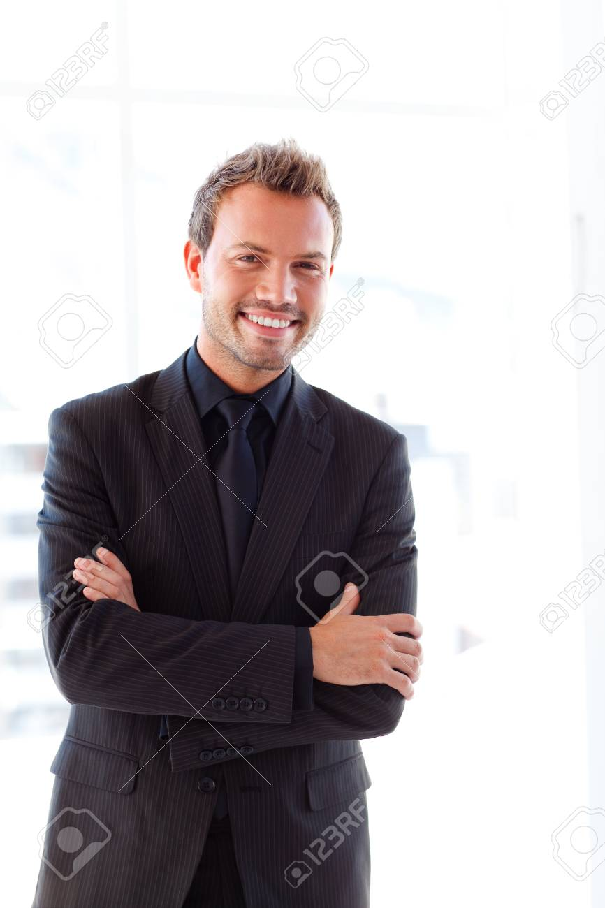 Handsome smiling businessman with folded arms Stock Photo - 10249709