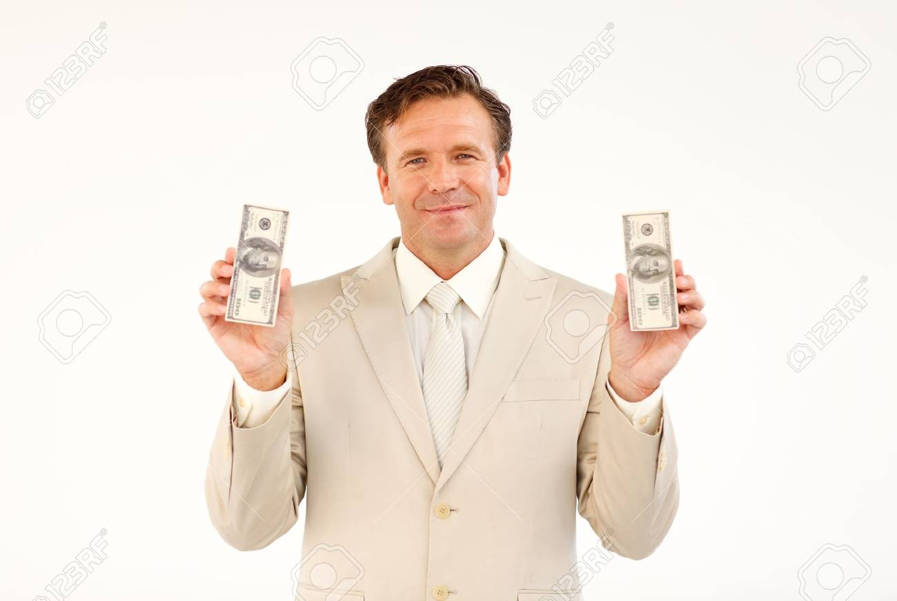 Handsome businessman holding money Stock Photo - 10250306