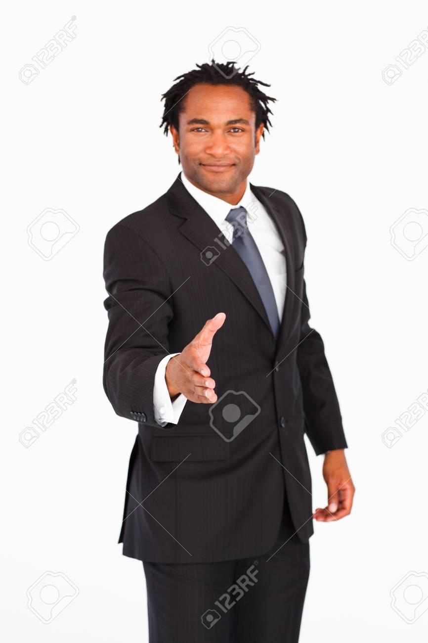 Serious businessman greeting with handshake Stock Photo - 10249349