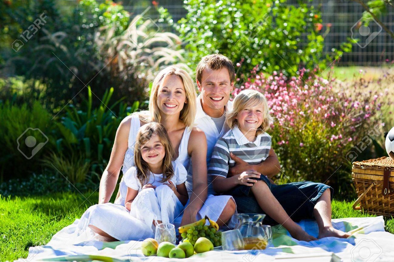 Cute family enjoying a picnic Stock Photo - 10250032