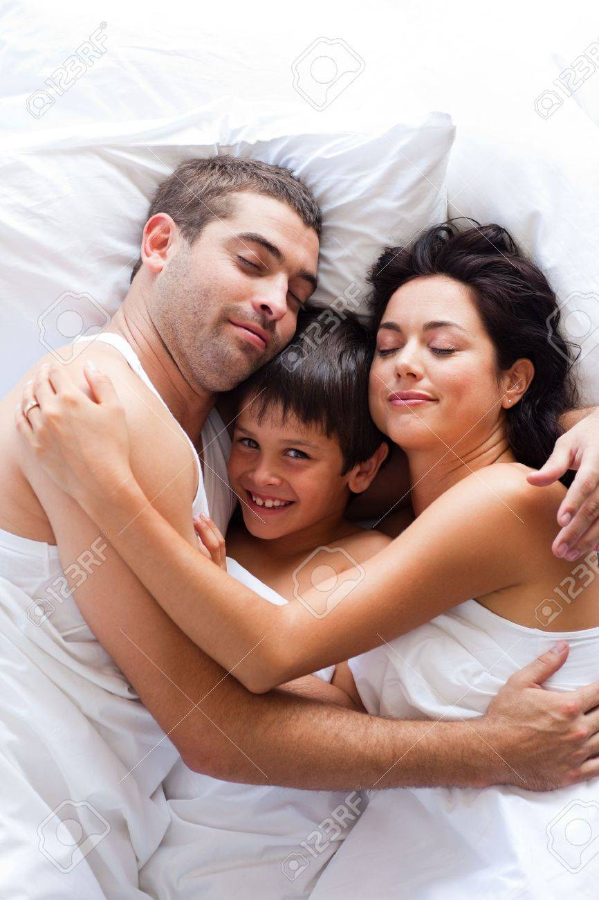 Lovely Couple In Bed Lying In Bedroom Happy Family Lying In Bed Stock Photo Picture And Royalty Free