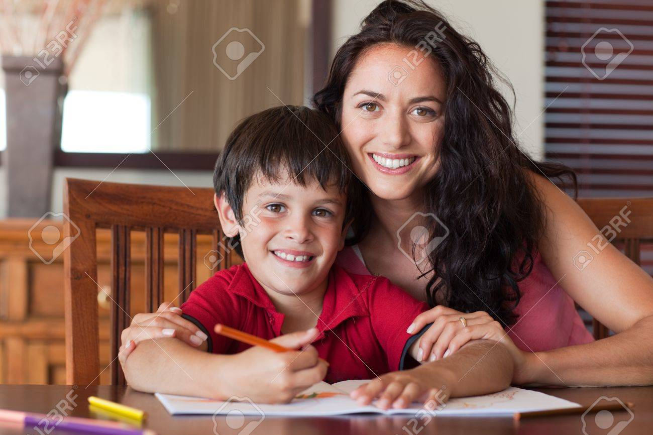 Happy mother helping his son for homework Stock Photo - 10249981