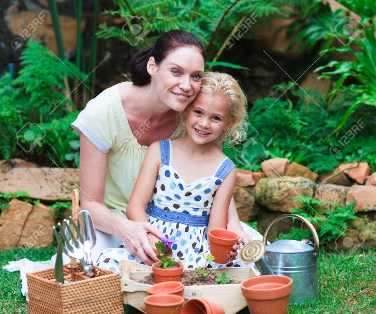 Mother and daughter planting in their garden Stock Photo - 10248756
