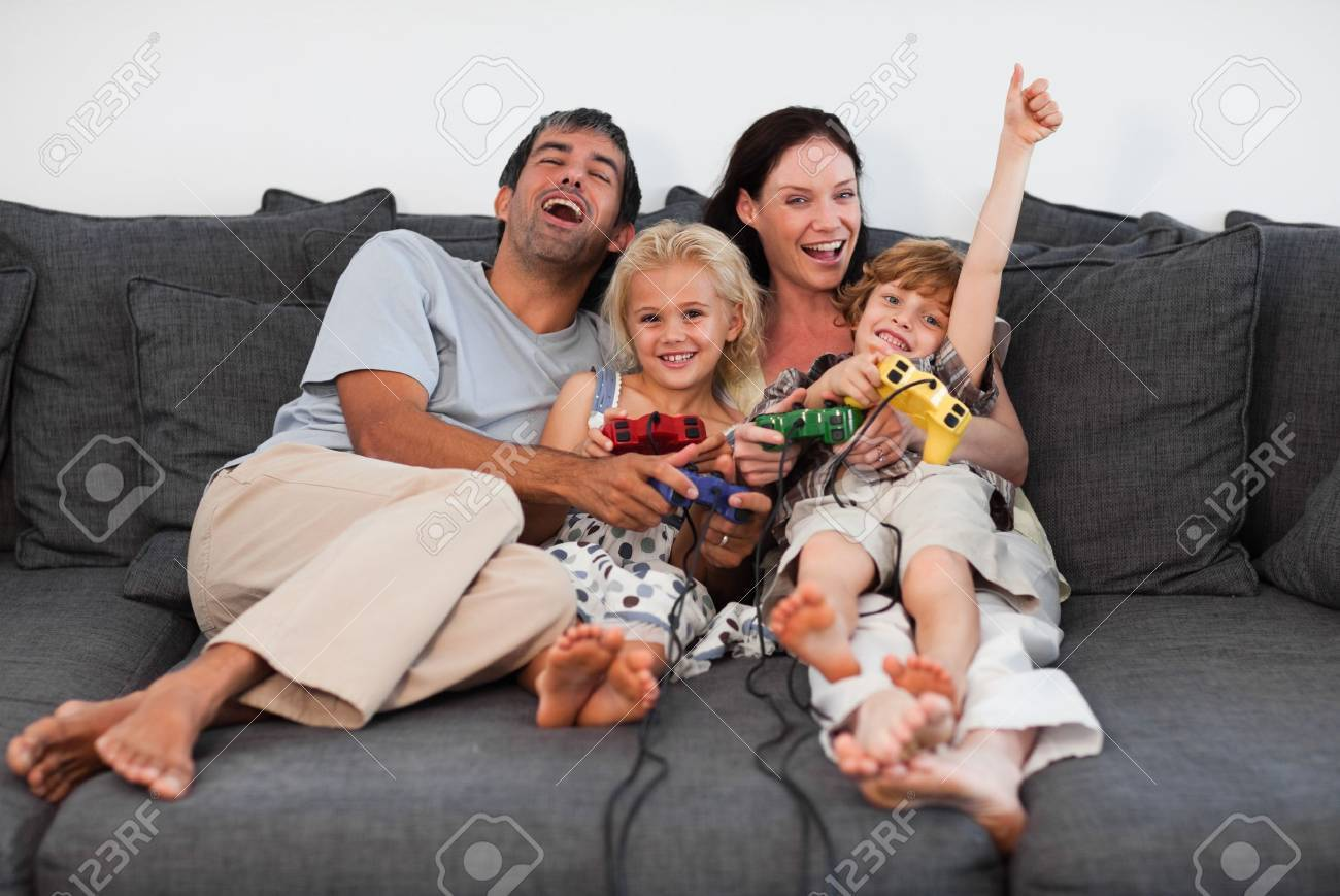 Joyful family playing video games at home Stock Photo - 10249927