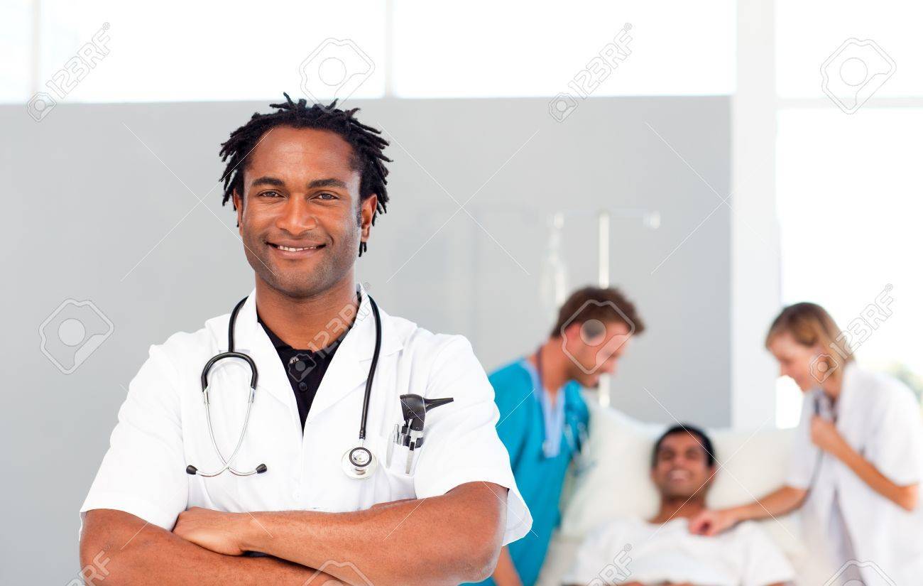 International doctors attending to a patient Stock Photo - 10246055