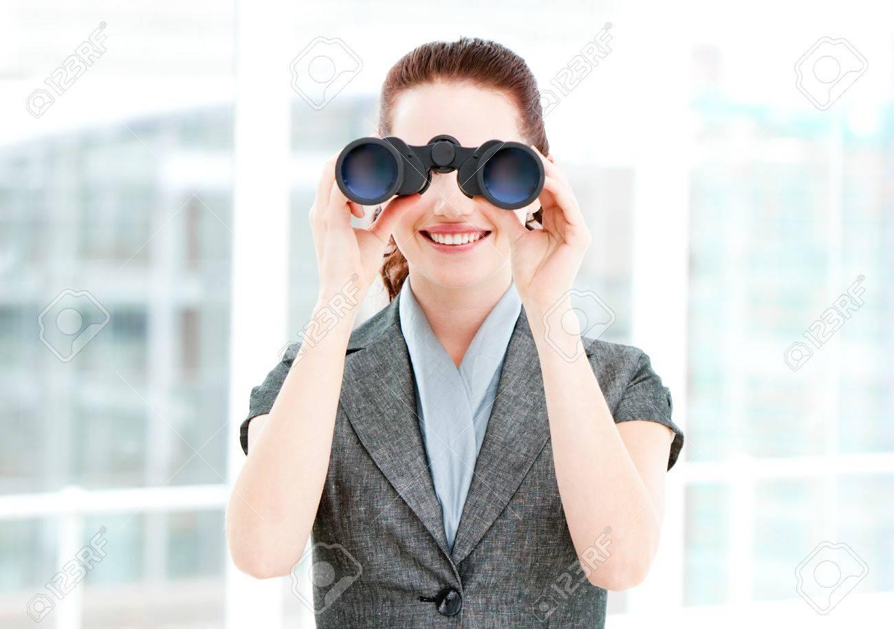 Pretty businesswoman using binoculars Stock Photo - 10249146