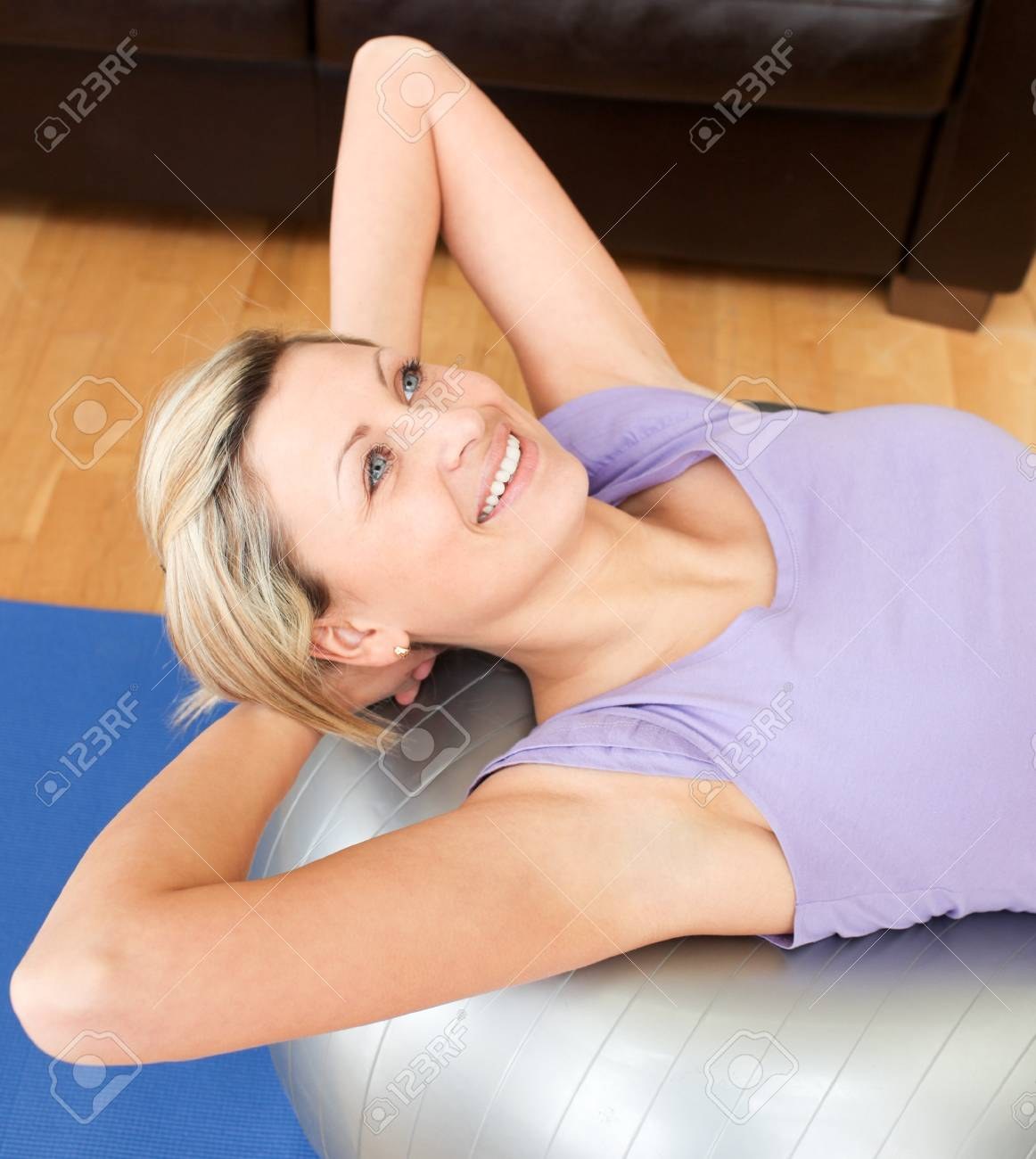 Smiling woman doing exercice Stock Photo - 10249079
