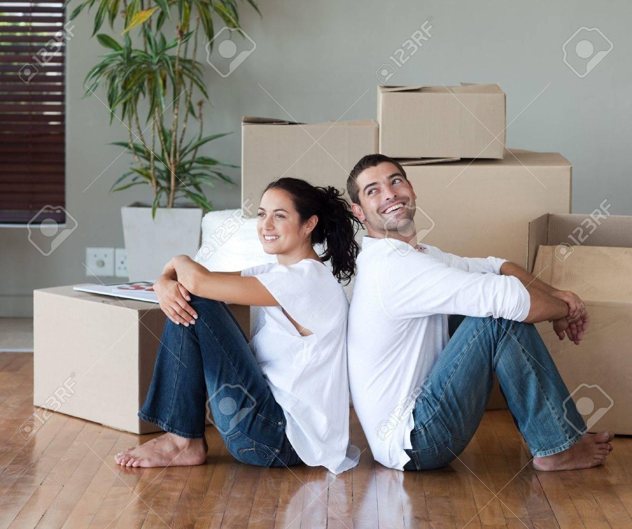 Glowing couple sitting on the floor Stock Photo - 10250188