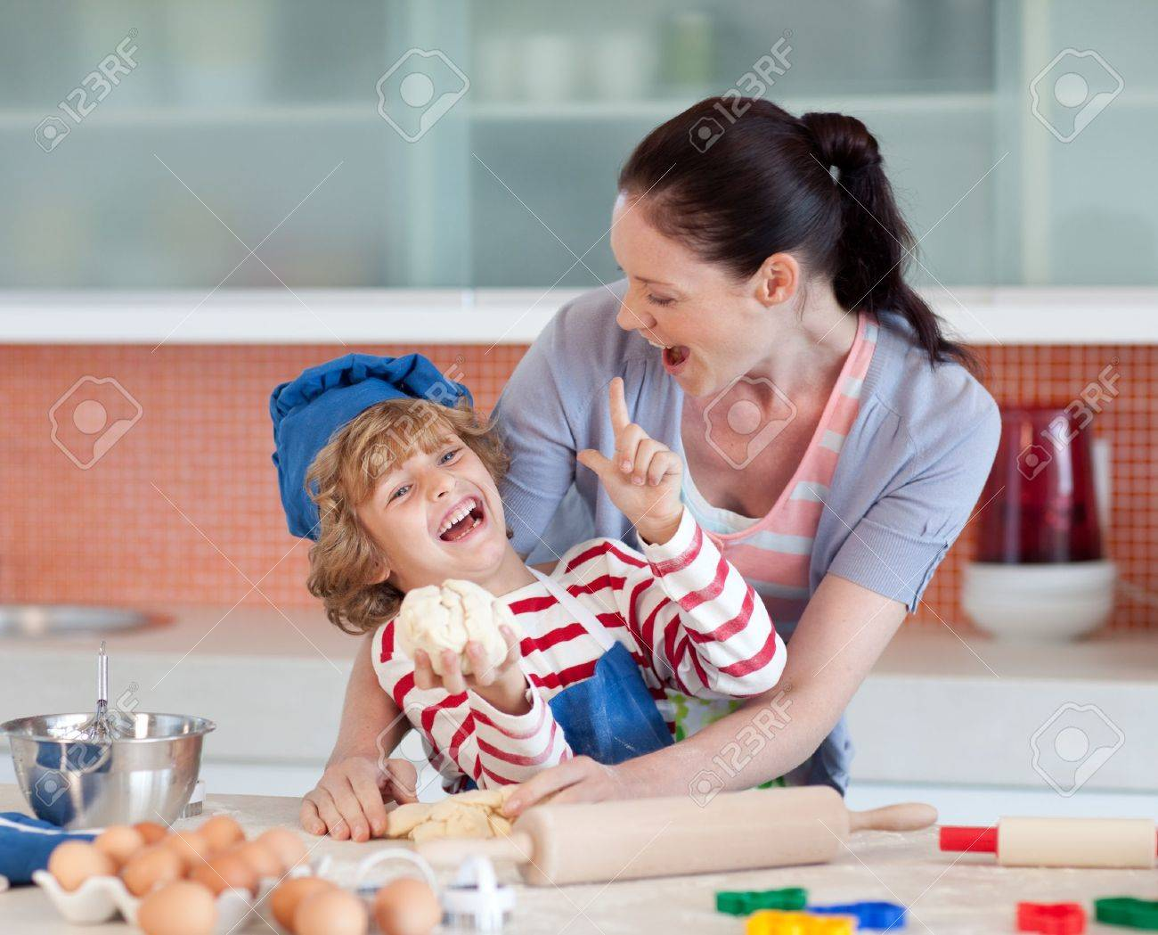 Laughing family having fun in the kitchen Stock Photo - 10249778