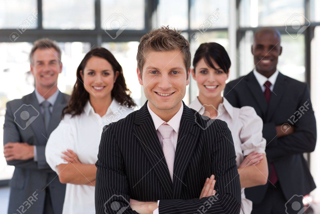 Cute business team looking at the camera Stock Photo - 10248532
