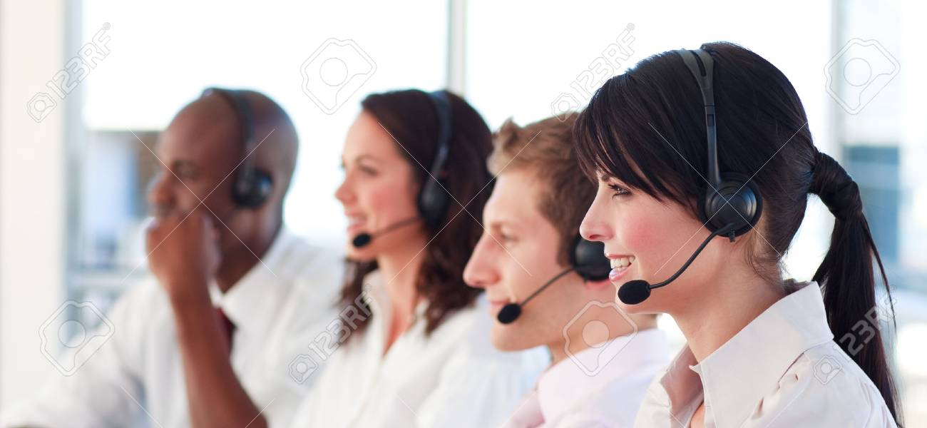 Portrait of a joyful multi-ethnic sale representative team at work Stock Photo - 10245873