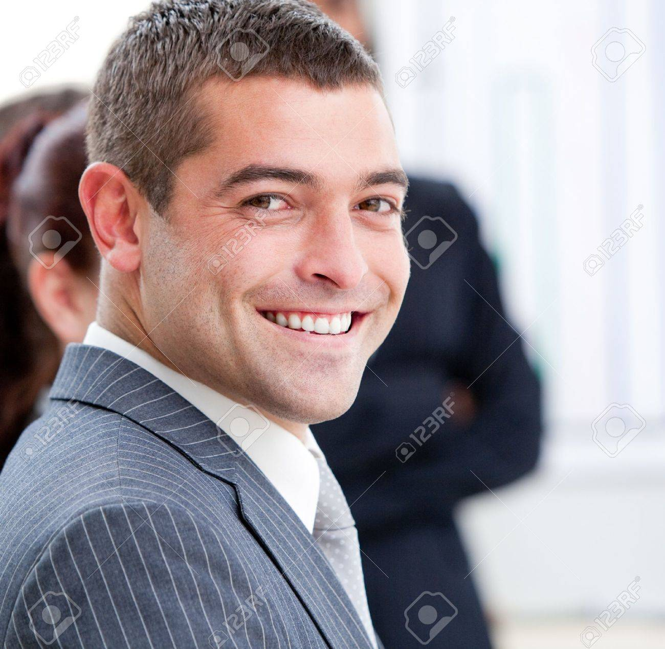 Close-up of a smiling businessman at a presentation Stock Photo - 10249380