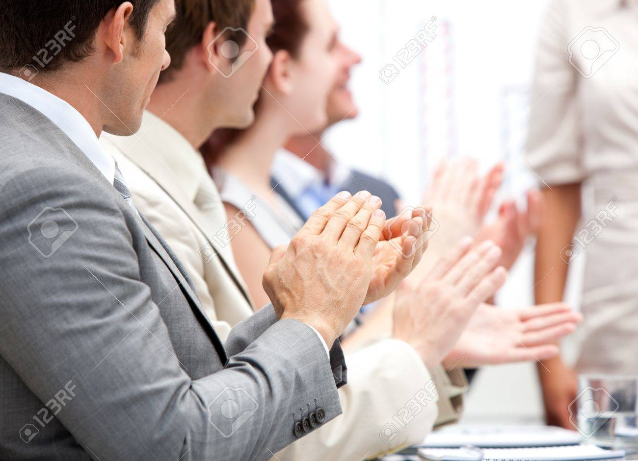 Portrait of a businessteam applauding during a meeting Stock Photo - 10248134