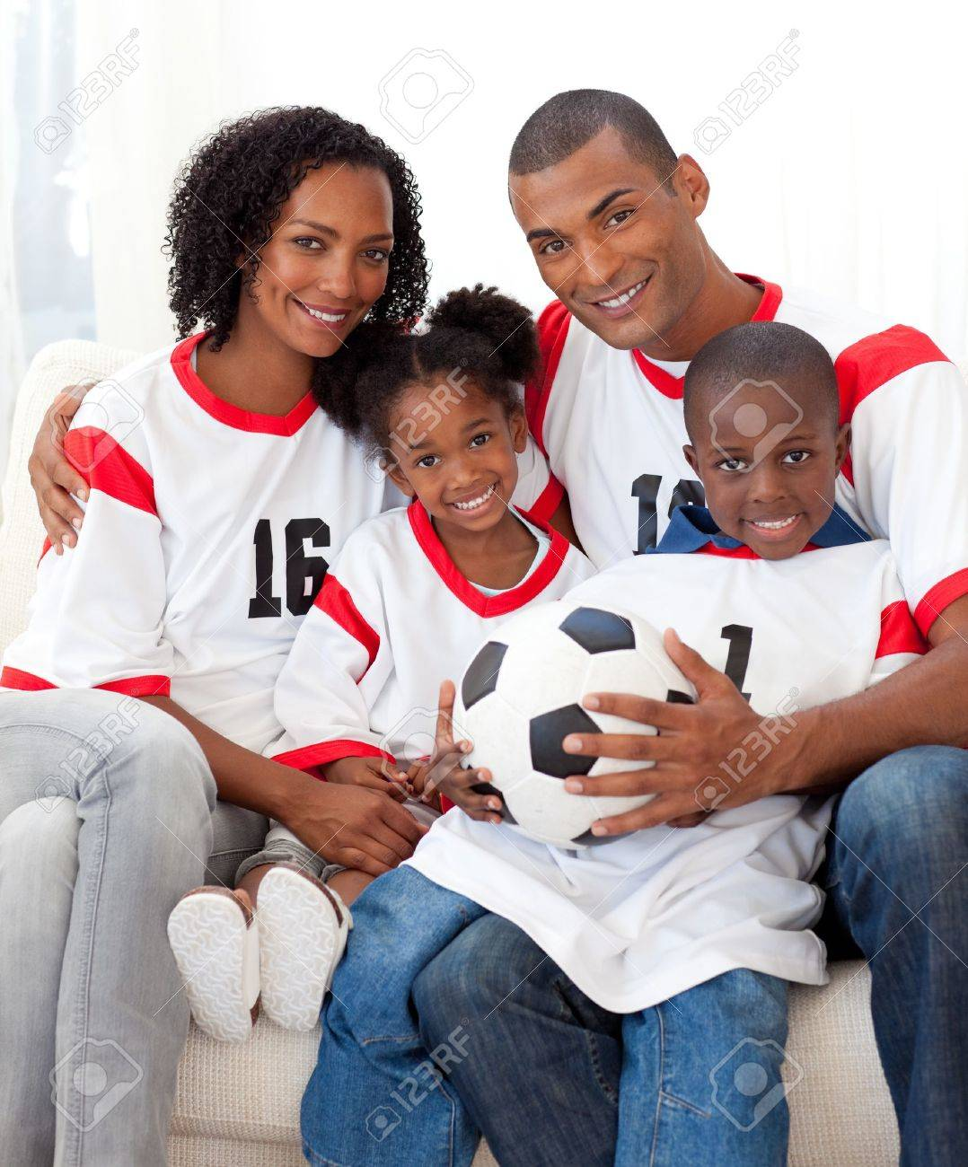 Smiling family holding a soccer ball Stock Photo - 10248153
